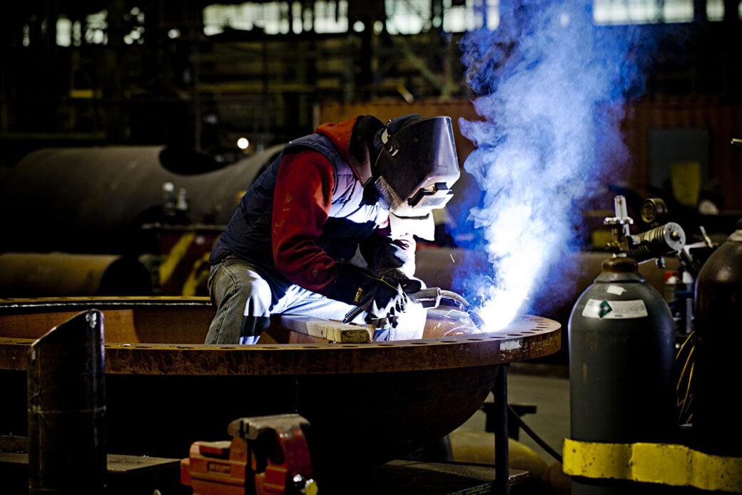 welder in workshop welding