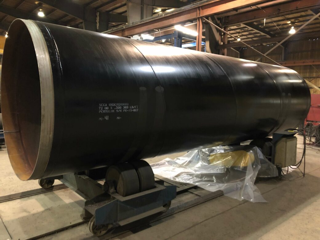 prodcuts permalok large black pipe on stand in building