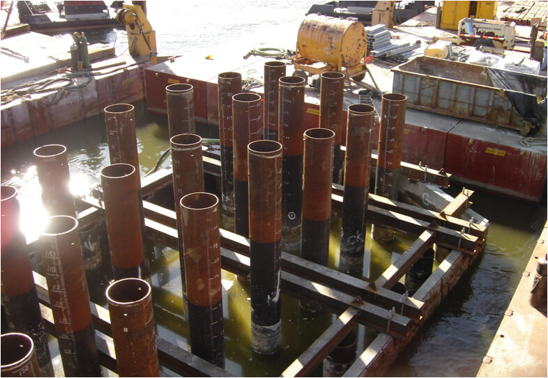 products piling redish pipe partly submerged