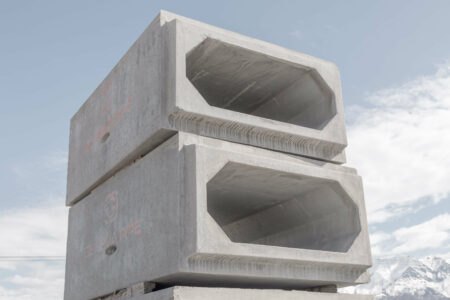 products rcp and precast box culverts stacked with sky background