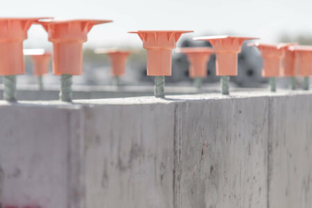 products rcp and precast other structures orange caps on metal rods