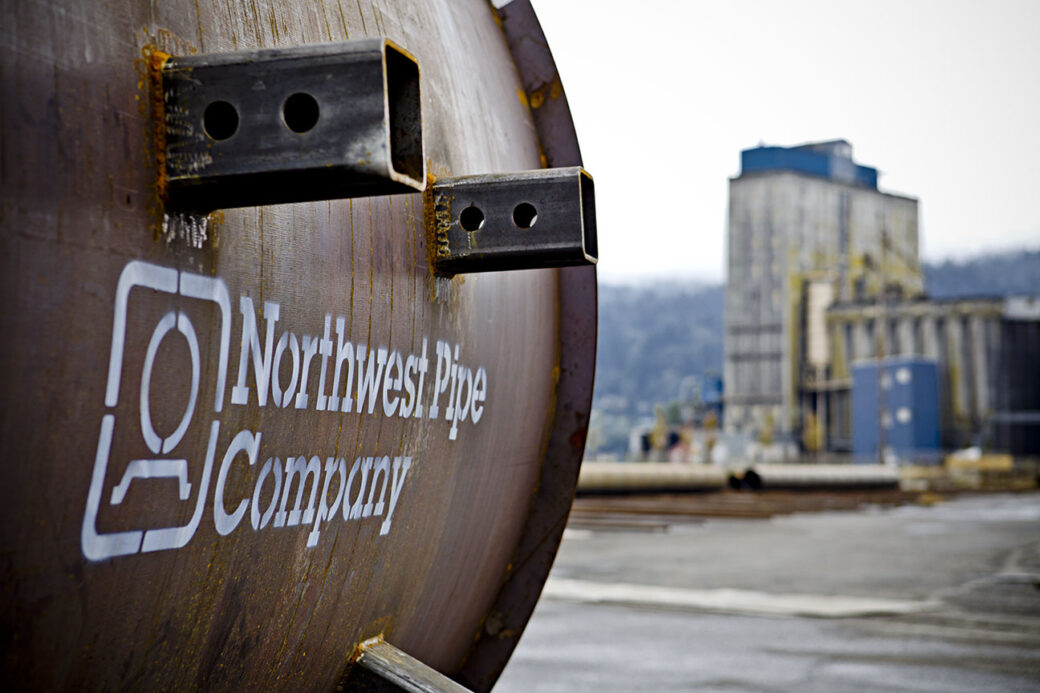 close up of northwest pipe company logo on steel pipe at portland production facility