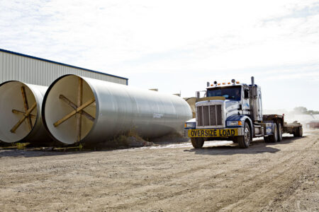 semi truck and large pipes