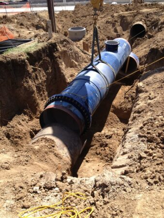 denver water blue pipe in dirt