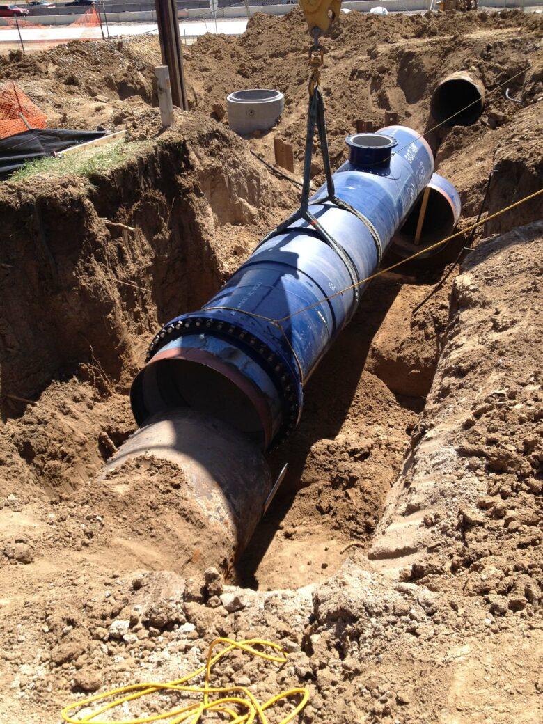 denver water blue pipe in dirt