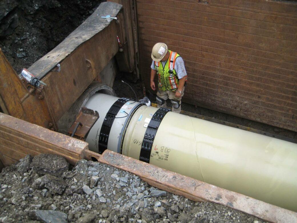 kearney man adjusting pipe