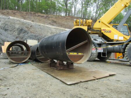 old dominion pipe in front of crane