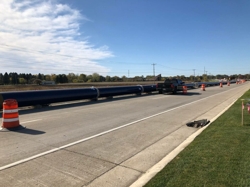 racine water transmission long pipe in road