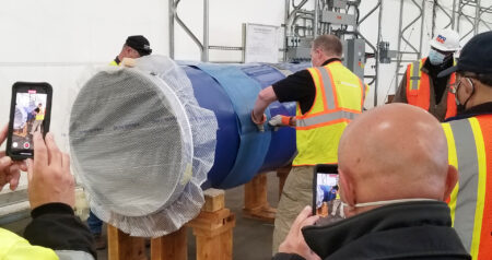 Applying heat shrink sleeve to poly coated 36-inch pipe section demonstration