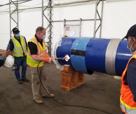 Applying heat shrink sleeve to 36-inch diameter steel pipe joint